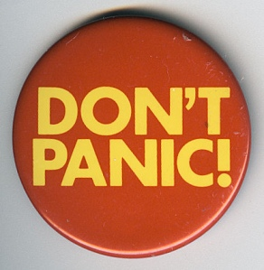 "A button that reads ""Don't Panic"""